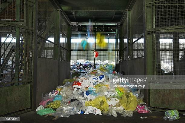 Growing pile of separated plastic bags await reprocessing into composite lumber