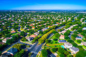 Round Rock , Texas , USA aerial drone view high above Suburb Neighborhood with Vast amount of Homes - Summertime in the best place to live in America