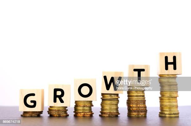 Growth Word on Wood Block on Top of Coins Stack