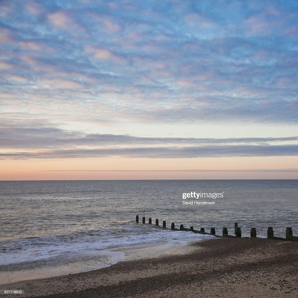 Groyne and dawn sky : Stock Photo