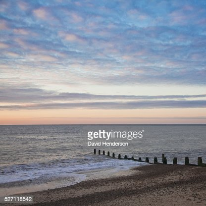 Groyne and dawn sky : Stock-Foto
