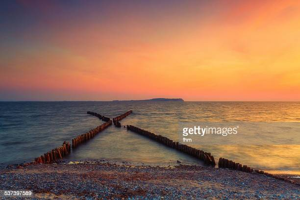 Groynes in a colorful sunset