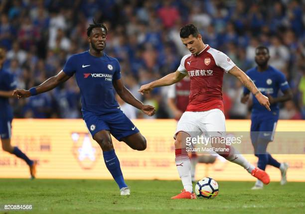 Grsnit Xhaka of Arsenal takes on Michy Batshuayi of Chelsea during the pre season friendly between Arsenal and Chelsea at the Birds Nest on July 22...