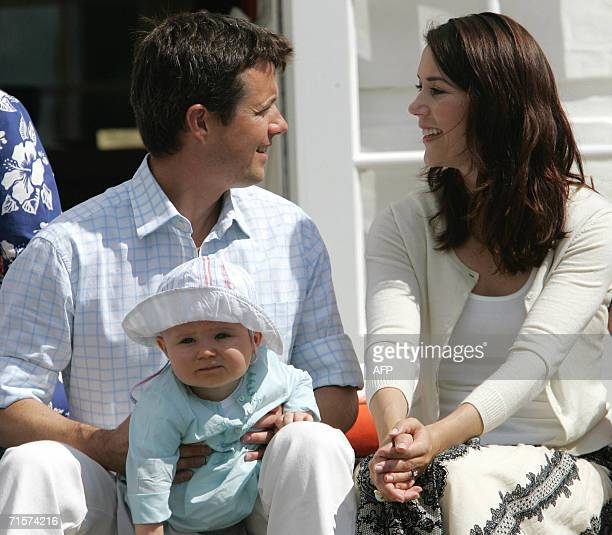 Denmark's Crown Prince Frederik looks at his wife Mary as he holds his son Christian during a photoshoot on the steps of Grsten Castle 03 August 2006...