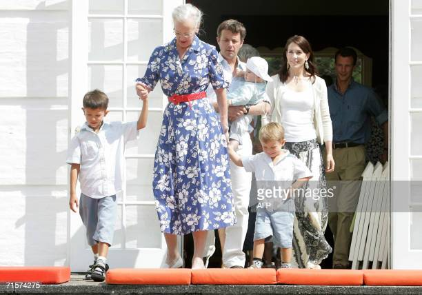 Denmark's Queen Margrethe leads her two grandsons Nikolai and Felix followed by Crown Prince Frederik holding son Christian and wife Mary onto the...