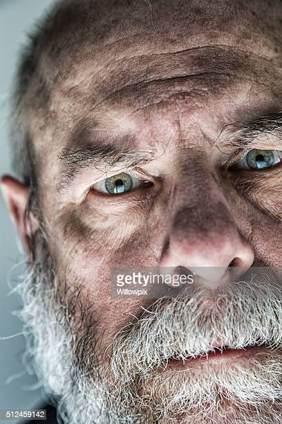 Grubby Skin Senior Man Ominous Staring Face Extreme Close-Up Portrait