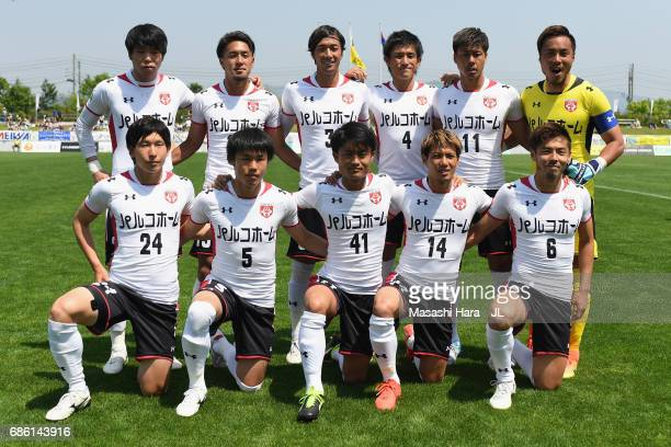 Grulla Moroika players line up for the team photos prior to the JLeague J3 match between Grulla Moroika and FC Tokyo U23 at Iwagin Stadium on May 21...