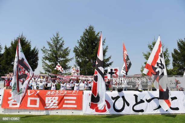 Grulla Moroika supporters cheer prior to the JLeague J3 match between Grulla Moroika and FC Tokyo U23 at Iwagin Stadium on May 21 2017 in Morioka...