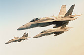 Grumman F-14 Tomcat and two McDonnell Douglas F-18 Super Hornets