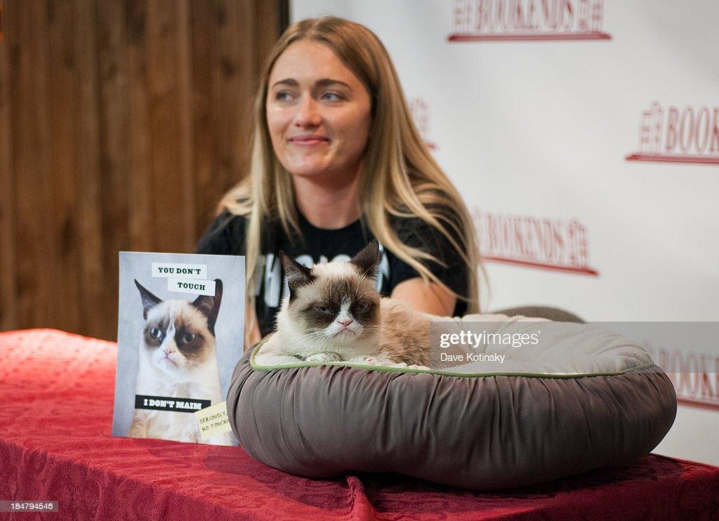 Grumpy Cat and her owner Tabatha Bundesen attend the 'Grumpy Cat: A Grumpy Book' Book Event at Bookends Bookstore on October 16, 2013 in Ridgewood, New Jersey.