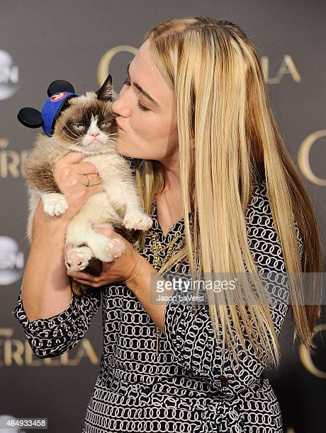 Grumpy Cat and Tabatha Bundesen attend the premiere of 'Cinderella' at the El Capitan Theatre on March 1 2015 in Hollywood California