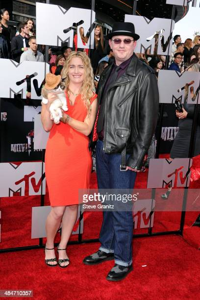 Grumpy Cat with owners Tabatha Bundesen and Bryan Bundesen attends the 2014 MTV Movie Awards at Nokia Theatre LA Live on April 13 2014 in Los Angeles...