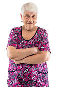 Grumpy elderly lady with arms crossed on white background