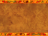 Grunge horizontal background with old paper texture of brown color and borders with ethnicity ornaments