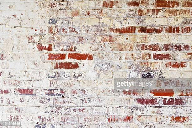 Grunge brick wall with peeling paint