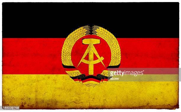 Grunge Former East German Flag on rough edged old postcard
