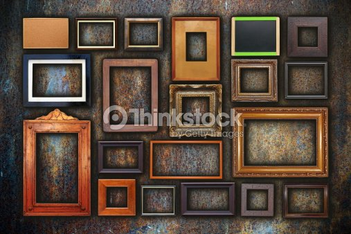 Grunge Wall Full Of Old Frames Stock Photo Thinkstock