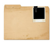 Grungy Manila Folder with picture isolated on white