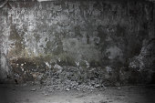 Background. Concrete wall in dark abandoned room.