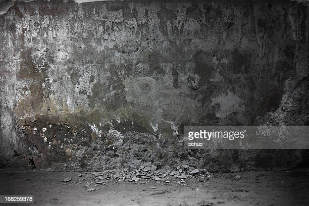 Grungy looking concrete wall in a dark environment