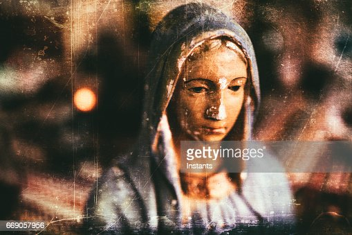 Grungy processing of an old and chipped plaster bust of Virgin Mary, one of the iconic figures of some Christian religion. : Stock Photo