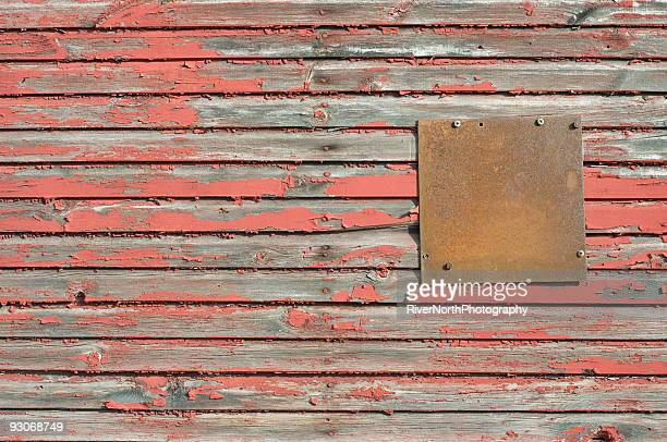 Grungy Red Barn Wall With Rusty Metal Plate