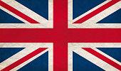Grungy UK flag, retro paper texture.