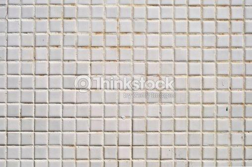 Grungy White Square Ceramic Tiles Texture Stock Photo