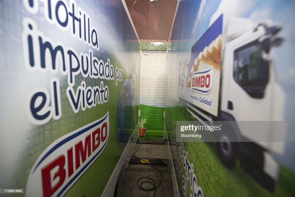 A Grupo Bimbo SAB de CV electric delivery truck is charged inside the company's new sales center in Mexico City, Mexico, on Thursday, July 18, 2013. Grupo Bimbo inaugurated a new eco-friendly sales center today. Photographer: Susana Gonzalez/Bloomberg via Getty Images