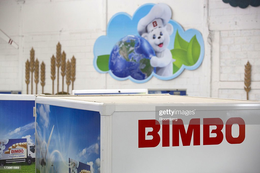 Grupo Bimbo SAB de CV signage is displayed on an electric delivery truck in Mexico City, Mexico, on Thursday, July 18, 2013. Grupo Bimbo inaugurated a new eco-friendly sales center today. Photographer: Susana Gonzalez/Bloomberg via Getty Images