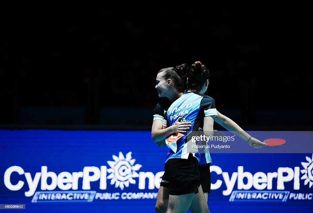 Grybowska Katarzyna and Partyka Natalia of Poland react after defeating Lee Ho Ching and Ng Wing Nam of Hong Kong during the Women's Doubles semi final of the 2014 ITTF World Tour Grand Finals at Huamark Indoor Stadium on December 13, 2014 in Bangkok, Thailand.