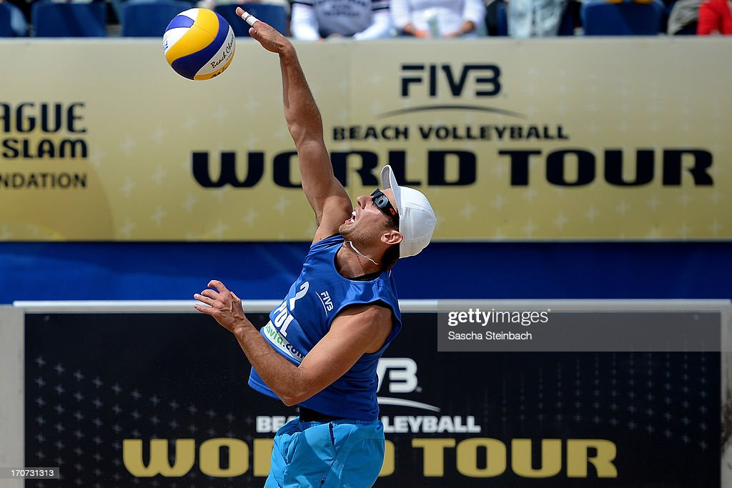 Grzegorz Fijalek of Poland smashes the ball during the FIVB Grand Slam final match day at The Hague Beach Stadium on June 16, 2013 in The Hague, Netherlands.