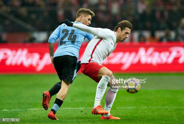 Grzegorz Krychowiak from Poland fights for the ball with Guillermon Verela from Uruguay while Poland v Uruguay International Friendly soccer match at...
