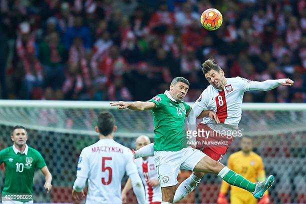 Grzegorz Krychowiak from Poland fights for the ball with Jon Walters of Republic of Ireland during the UEFA EURO 2016 qualifying match between Poland...