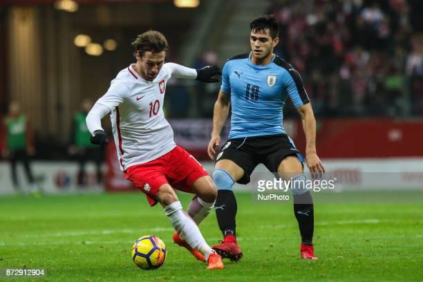 Grzegorz Krychowiak Maximiliano Gomez in action during the international friendly match between Poland and Uruguay at National Stadium on November 10...