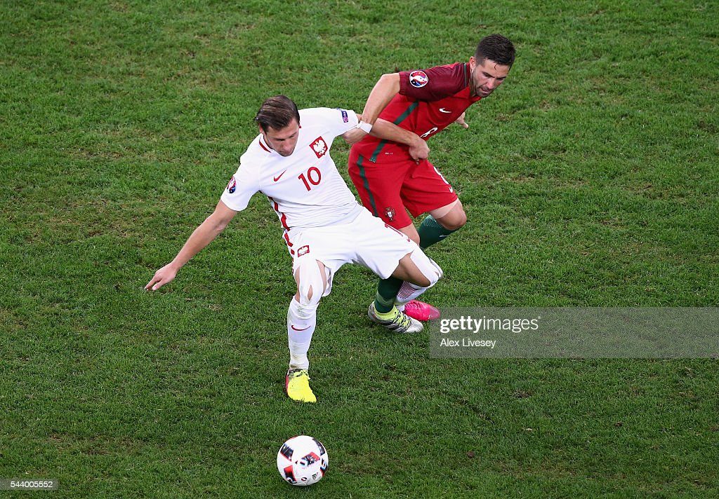 <a gi-track='captionPersonalityLinkClicked' href=/galleries/search?phrase=Grzegorz+Krychowiak&family=editorial&specificpeople=4379669 ng-click='$event.stopPropagation()'>Grzegorz Krychowiak</a> of Poland and Joao Moutinho of Portugal compete for the ball during the UEFA EURO 2016 quarter final match between Poland and Portugal at Stade Velodrome on June 30, 2016 in Marseille, France.