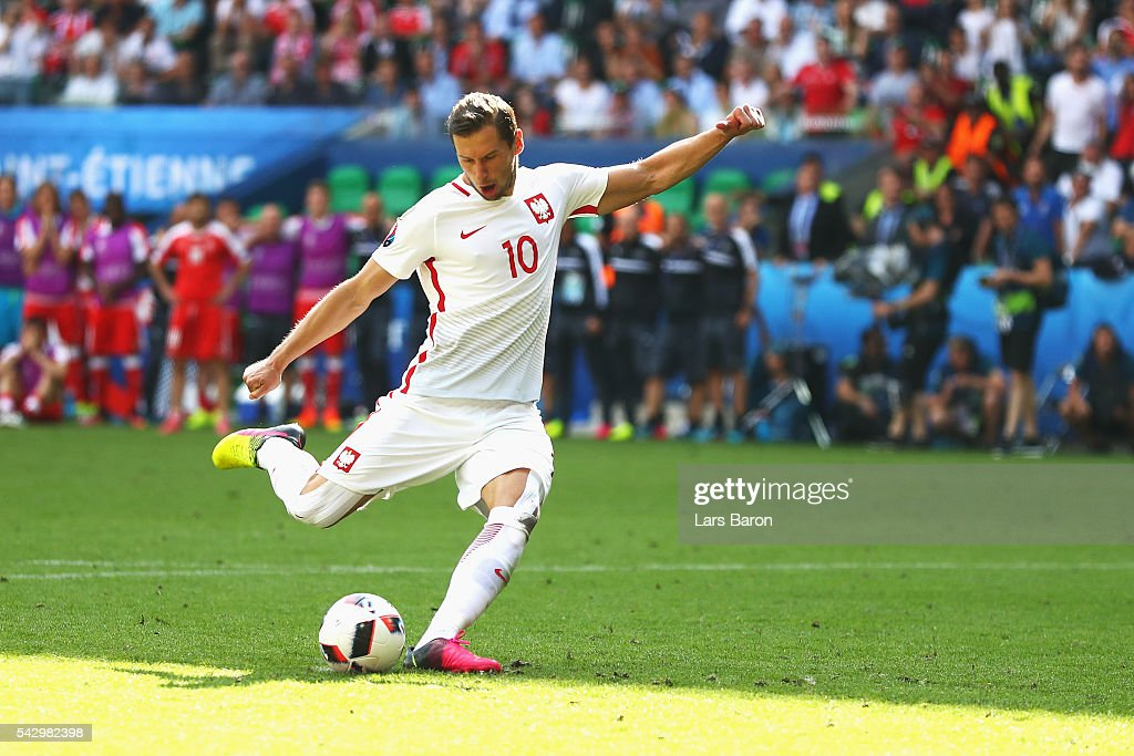 <a gi-track='captionPersonalityLinkClicked' href=/galleries/search?phrase=Grzegorz+Krychowiak&family=editorial&specificpeople=4379669 ng-click='$event.stopPropagation()'>Grzegorz Krychowiak</a> of Poland scores at the penalty shootout to win the game during the UEFA EURO 2016 round of 16 match between Switzerland and Poland at Stade Geoffroy-Guichard on June 25, 2016 in Saint-Etienne, France.
