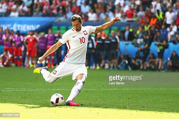 Grzegorz Krychowiak of Poland scores at the penalty shootout to win the game during the UEFA EURO 2016 round of 16 match between Switzerland and...