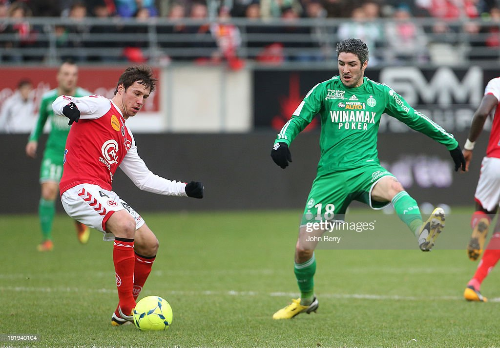 Grzegorz Krychowiak of Reims and <a gi-track='captionPersonalityLinkClicked' href=/galleries/search?phrase=Fabien+Lemoine&family=editorial&specificpeople=4784581 ng-click='$event.stopPropagation()'>Fabien Lemoine</a> of ASSE in action during the french Ligue 1 match between Stade de Reims and AS Saint-Etienne at the Stade Auguste Delaune on February 17, 2013 in Reims, France.