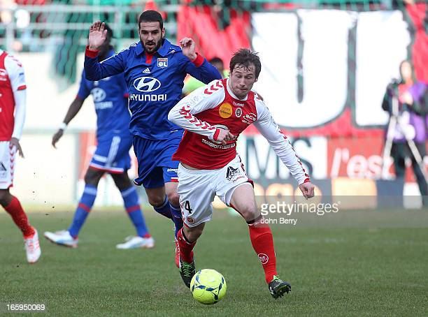 Grzegorz Krychowiak of Reims and Lisandro Lopez of Lyon in action during the French Ligue 1 match between Stade de Reims and Olympique Lyonnais at...