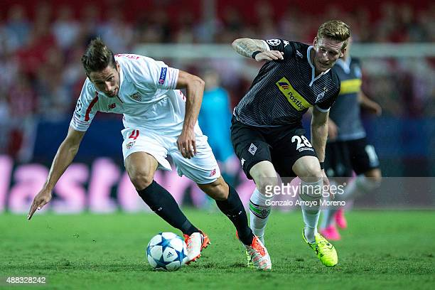Grzegorz Krychowiak of Sevilla FC competes for the ball with Andre Hahn of Borussia Monchengladbach during the UEFA Champions League Group D match...