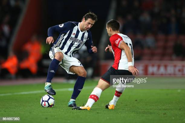 Grzegorz Krychowiak of West Bromwich Albion and Dusan Tadic of Southampton battle for the ball during the Premier League match between Southampton...