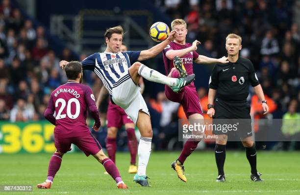 Grzegorz Krychowiak of West Bromwich Albion and Kevin De Bruyne of Manchester City battle for possession during the Premier League match between West...