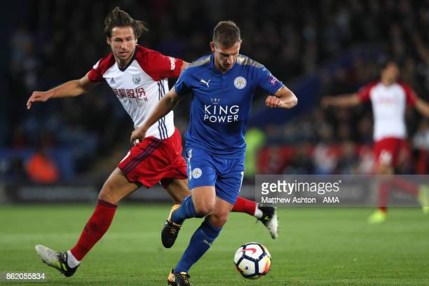 Grzegorz Krychowiak of West Bromwich Albion competes with Marc Albrighton of Leicester City during the Premier League match between Leicester City...