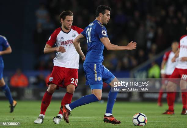 Grzegorz Krychowiak of West Bromwich Albion competes with Vicente Iborra of Leicester City during the Premier League match between Leicester City and...