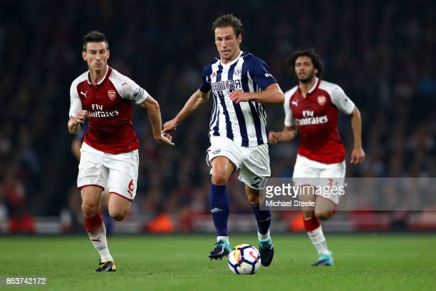 Grzegorz Krychowiak of West Bromwich Albion is chased by Laurent Koscielny of Arsenal during the Premier League match between Arsenal and West...
