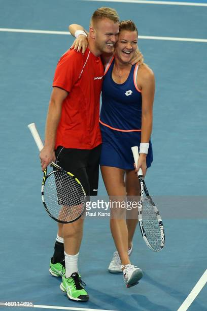 Grzegorz Panfil and Agnieszka Radwanska of Poland celebrate winning the second set in the mixed doubles match against Sam Stosur and Bernard Tomic of...