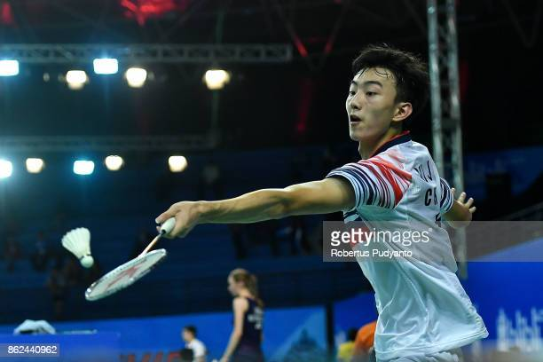 Gu Junfeng of China competes against Kunlavut Vitidsarn of Thailand during Men Single qualification round of the BWF World Junior Championships 2017...