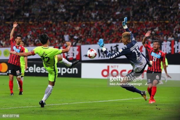 Gu Sung Yun of Consadole Sapporo saves a shot by Yuki Abe of Urawa Red Diamonds during the JLeague J1 match between Consadole Sapporo and Urawa Red...