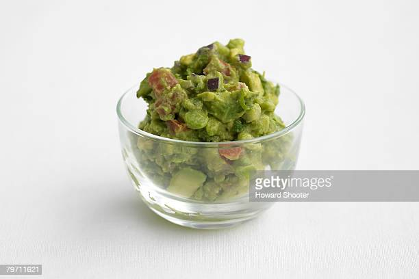Guacamole in a glass bowl, studio shot